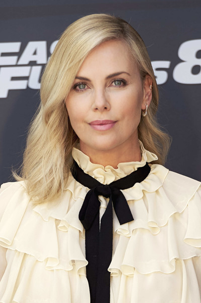 Charlize Theron Medium Wavy Cut [madrid photocall,fast furious,hair,blond,hairstyle,clothing,bow tie,beauty,lip,long hair,tie,collar,charlize theron,fast furious 8,madrid,spain,villamagna hotel,photocall]