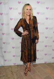 Molly Sims matched her dress with a pair of animal-print gladiator heels.