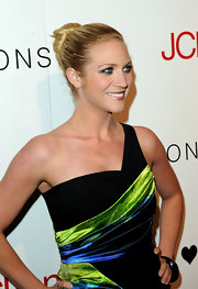The sweet-faced actress sported a classic twisted bun with her asymmetrical mini dress.