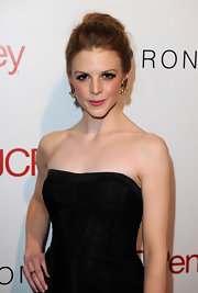 Ashley styled her red-hot locks in a classic twisted bun. Her softened style kept her look sweet and youthful.