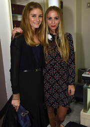 Olivia Palermo styled her black dress with a chic gold lattice cuff for the VIP Beauty launch.