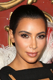 Kim Kardashian kept it low-key with this simple bun at the Make-Up Your Destiny Beauty Festival.