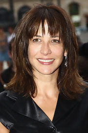 Sophie Marceau's medium layered haircut gave her hair more shape and movement.