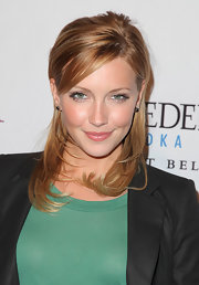Katie Cassidy showed off her newly dyed tresses at the book party for Chelsea Handler. Although she still looks gorgeous we much prefer her blonde locks.