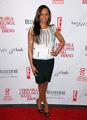 The former Spice Girl attended the book party in a somewhat boring look complete with a classic pair of black patent leather peep toe pumps. (Yawn)