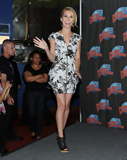 Chelsea wore leather, peep toe wedge boots with a printed mini dress.