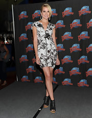 Chelsea wore a printed, zip-front mini dress with peep toe ankle booties and white dangling earrings.