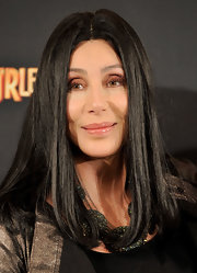Cher showed off sleek center part locks at the 'Burlesque' photo call.
