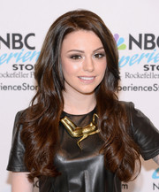 Cher Lloyd styled her leather outfit with a huge gold statement necklace.