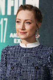 Saoirse Ronan attended the European premiere of 'On Chesil Beach' wearing a stunning pair of gemstone chandelier earrings by Giampiero Bodino.
