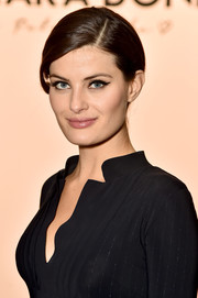 Isabeli Fontana attended the Chiara Boni La Petite Robe fashion show wearing her hair in a side-parted bun.