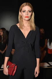 Mischa Barton attended the Chiara Boni La Petite Robe fashion show carrying an elegant red chain-strap bag by Bulgari.