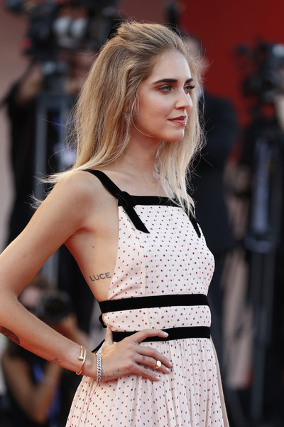 Chiara Ferragni Lettering Tattoo [the young pope premiere,the young pope,fashion model,hair,clothing,fashion,beauty,hairstyle,lady,long hair,blond,lip,chiara ferragni,venice,italy,venice film festival,premiere]