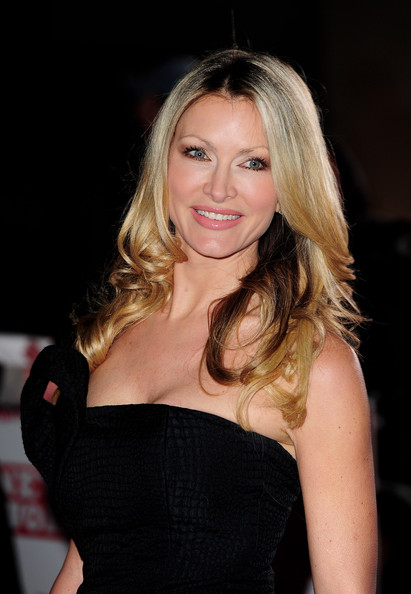 Caprice wore her hair in pretty glossy waves to the 2010 Children's Champions Awards in London.