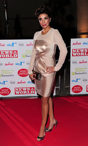 A pair of metallic slingback sandals added a modern touch to Shobna's ladylike evening look.