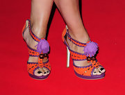 Denise van Outen added a splash of colors to her outfit by wearing a pair of pretty platform sandals.