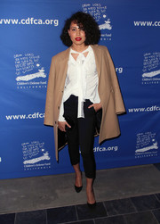 A pair of black capris completed Jurnee Smollett-Bell's outfit.