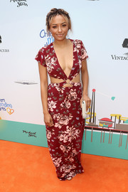 Kat Graham brought her ultra-sexy style to the Empathy Rocks event with this plunging floral cutout dress.