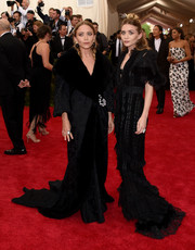 Mary-Kate Olsen was vintage-glam in a fur-trimmed black opera coat by John Galliano for Dior during the Met Gala.