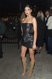 Shanina Shaik looked fierce in a strapless black leather mini by Balmain while attending a Met Gala after-party.