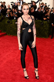 Cara Delevingne brought a dose of edge to the Met Gala red carpet with this black Stella McCartney cutout jumpsuit.