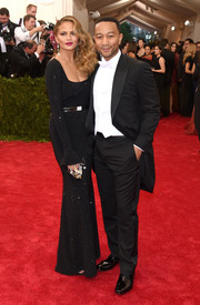 Chrissy Teigen kept it classic at the Met Gala in a micro-beaded black gown by St. John.