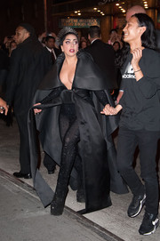 Lady Gaga looked like a black-clad superhero in her caped and belted catsuit while making her way to a Met Gala after-party.