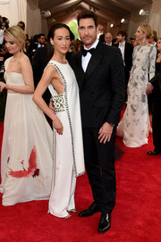 Maggie Q worked the Met Gala red carpet in a custom Tory Burch embellished tunic dress and matching pants.