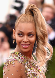 Beyonce Knowles couldn't be missed with her funky ponytail (not to mention that barely-there dress) at the Met Gala.