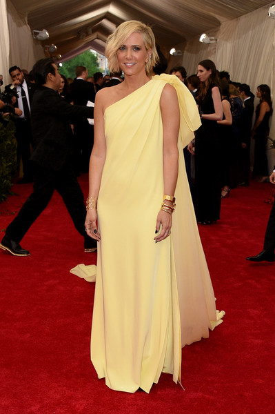 Kristen Wiig was a summer goddess in a floaty yellow one-shoulder gown by Prabal Gurung at the Met Gala.