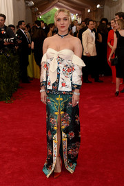 For her Met Gala look, Chloe Sevigny chose a J.W. Anderson off-the-shoulder gown with a high front slit and a blend of Asian-inspired embroidery.