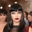 Adriana Lima's Long Wavy Cut with Bangs