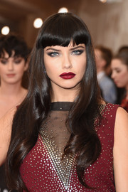 Adriana Lima wore her hair loose and wavy with blunt bangs during the Met Gala.