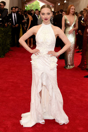 Amanda Seyfried worked the Met Gala red carpet in an appliqued white Givenchy Couture halter gown.