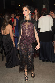 Georgina Chapman paired her sultry dress with elegant black strappy sandals.