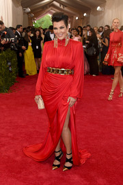 Kris Jenner channeled the '80s with this bold-shouldered, draped red gown by Balmain at the Met Gala.