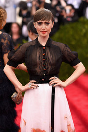 Black nail polish added an edgy touch to Lily Collins' ladylike look.