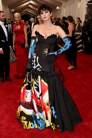 Katy Perry looked like a walking graffiti wall in her Moschino strapless print gown during the Met Gala.