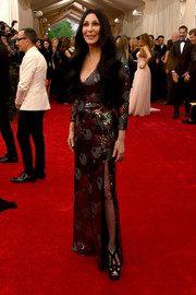 Cher flaunted her amazing figure in a low-cut, tight-fitting sequined gown by Marc Jacobs during the Met Gala.