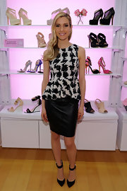Kristin Cavallari paired a knee-length leather skirt with a print peplum top for a cool mix of textures.