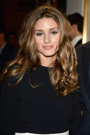 Olivia Palermo attended the 'Chloe Attitudes' book launch wearing her hair in messy-glam curls.
