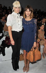 Alexa paired her lace embellished navy blue dress with a leather Aurore shoulder bag.
