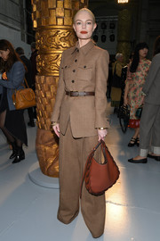 Kate Bosworth went tough-chic in a military-inspired brown pantsuit by Chloe during the brand's Fall 2020 show.