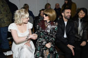 Lucy Boynton attended the Chloe Fall 2020 show wearing a silver statement bracelet.