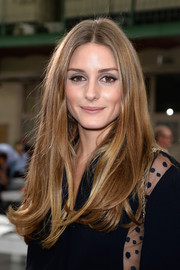 Olivia Palermo opted for a classic long center-parted 'do when she attended the Chloe fashion show.