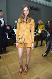 Chiara Ferragni teamed her suit with strappy rust-colored gladiator heels, also by Chloe.
