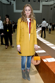 Olivia Palermo sported a lovely mix of colors with this yellow wool coat, red and white top, and blue jeans combo at the Chloe fashion show.