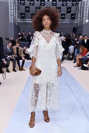 Solange Knowles paired her lovely dress with camel-colored diagonal-strap heels, also by Chloe.