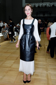 Ulyana Sergeenko knew just how to take the edge off a leather dress, cleverly layering it over a delicate white dress when she attended the Chloe fashion show.