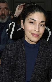 Caroline Issa wore a chic pair of dangling diamond earrings at the Chloe Fall 2015 show.